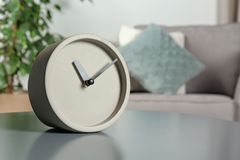 Analog clock on table indoors, space for text. Time management royalty free stock image