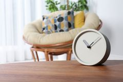 Analog clock on table indoors, space for text. Time management royalty free stock photos