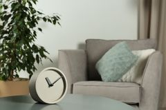 Analog clock on table indoors, space for text. Time management stock photos