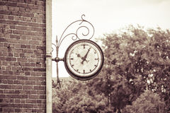 Analog clock on a wall Stock Photo