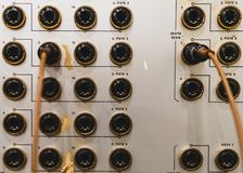 Analog connectors on a vintage soundboard royalty free stock image