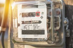 Analog electric meters. Watt hour electric meters. Electricity. Concept Stock Photography