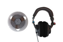 Analog magnetic tape and professional headphones Royalty Free Stock Image