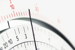 Analog measure tool multimeter scale with pointer. Close up view of multimeter scale with pointer. Selective focus on a center part royalty free stock photos