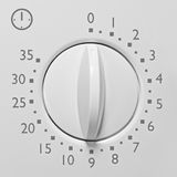Analog 35 minute microwave oven timer, analogue vintage white dial face macro closeup grey numbers and icon, large Stock Photography