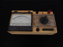 Analog Multimeter. A multimeter (Volt-Ohm meter or Volt-Ohm-milliammeter ), is an old electronic measuring instrument royalty free stock photo