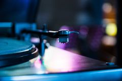 Analog music record player tentable. And bokeh background Royalty Free Stock Images