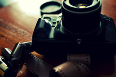 Analog photo camera and a film Royalty Free Stock Photography