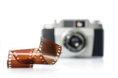 Analog photography. Analog film and antique camera in the backgound. selective focus. horizontal image stock photography