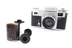 Analog rangefinder camera with 35mm film. Vintage analog rangefinder camera with 35mm film cartridge and spool Stock Photo