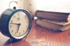 Analog retro alarm clock. On wooden table stock photo