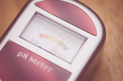 Analog soil ph meter on a wood surface Stock Images