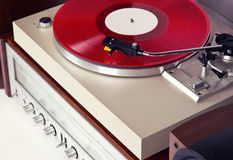 Analog Stereo Turntable Red Vinyl Record Player with Red Disk Royalty Free Stock Images