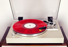 Analog Stereo Turntable Red Vinyl Record Player with Red Disk Stock Images