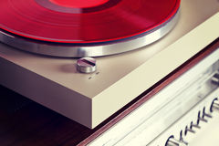Analog Stereo Turntable Red Vinyl Record Player with Red Disk Royalty Free Stock Photos