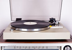 Analog Stereo Turntable Vinyl Record Player with Black Disk Royalty Free Stock Image