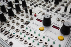 Analog synthesizer , knobs macro on music equipment Royalty Free Stock Photo
