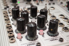 Analog synthesizer , knobs macro on music equipment Royalty Free Stock Image