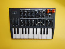 Analog Synthesizer on yellow background Stock Image