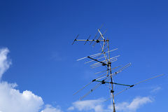 Analog tv antenna with blue sky background Royalty Free Stock Photos