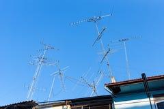 Analog tv antenna with blue sky background. Stock Image