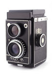 Analog vintage camera. Old, analog vintage camera on white background royalty free stock photography