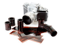 Analog vintage SLR camera and color negative films Royalty Free Stock Image