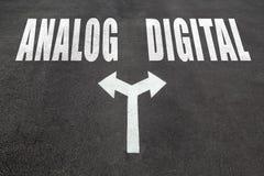 Analog vs digital choice concept. Two direction arrows on asphalt Stock Image