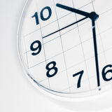 Analog wall clock. Narrow focus on number nine, tinted black and white image Royalty Free Stock Image