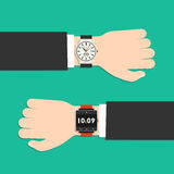 Analog watch and smart watch on businessman's hand Royalty Free Stock Image