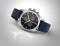Analog wristwatch with digital touch screen, and blue leather wristband Royalty Free Stock Image