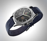 Analog wristwatch with digital touch screen, and blue leather wristband Royalty Free Stock Photography