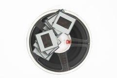 Analoge Filmplättchen und Filmbandspule Lizenzfreies Stockfoto