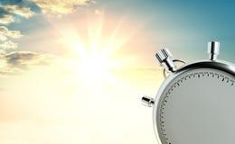 Analoge Stoppuhr vor dem hintergrund des Sonnenaufgangs Stockbild