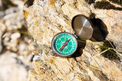 Analogic Compass Abandoned on the Rocks Stock Photo