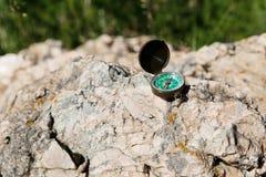 Analogic Compass Abandoned on the Rocks Royalty Free Stock Images