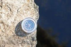 Analogic Compass Abandoned on the stone Stock Image