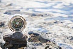 Analogic Compass Abandoned on the stone Stock Photos