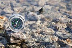 Analogic Compass Abandoned on the stone Royalty Free Stock Photo