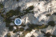 Analogic Compass Abandoned on the stone Royalty Free Stock Image