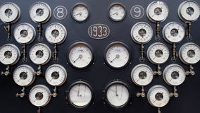 Analogue Gauge Wall. Industrial Water Steam Measurement. Vintage Background. A wall of analogue gauges for steam, water, pressure etc Royalty Free Stock Photos