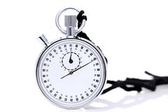 Analogue metal stopwatch. Analogue stopwatch with sport running shoes on white background Royalty Free Stock Image