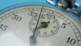 Analogue Metal Stopwatch on Blue Background