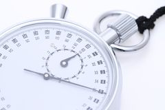 Analogue metal stopwatch. On the white background Stock Photography