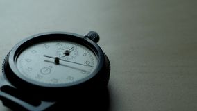 Analogue plastic stopwatch on the black background