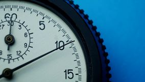 Analogue plastic stopwatch on blue background