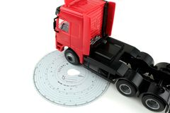 Analogue Tachograph card and truck. On white background Stock Images