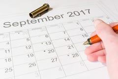 Analyse van een kalender September Stock Foto's