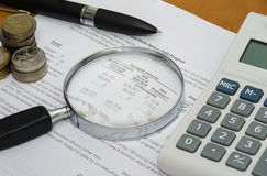 Analysing Balance Sheet / Annual report Royalty Free Stock Photo