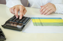 Analysing chart with calculator Royalty Free Stock Images